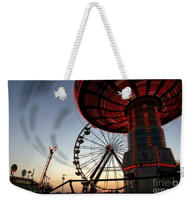 Fair Weekender Tote Bag featuring the photograph Twirling Away by David Lee Thompson
