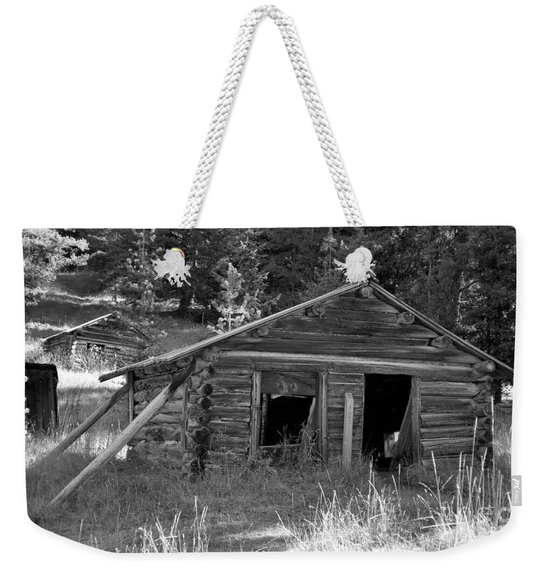 Abandoned Weekender Tote Bag featuring the photograph Two Cabins One Outhouse by Richard Rizzo