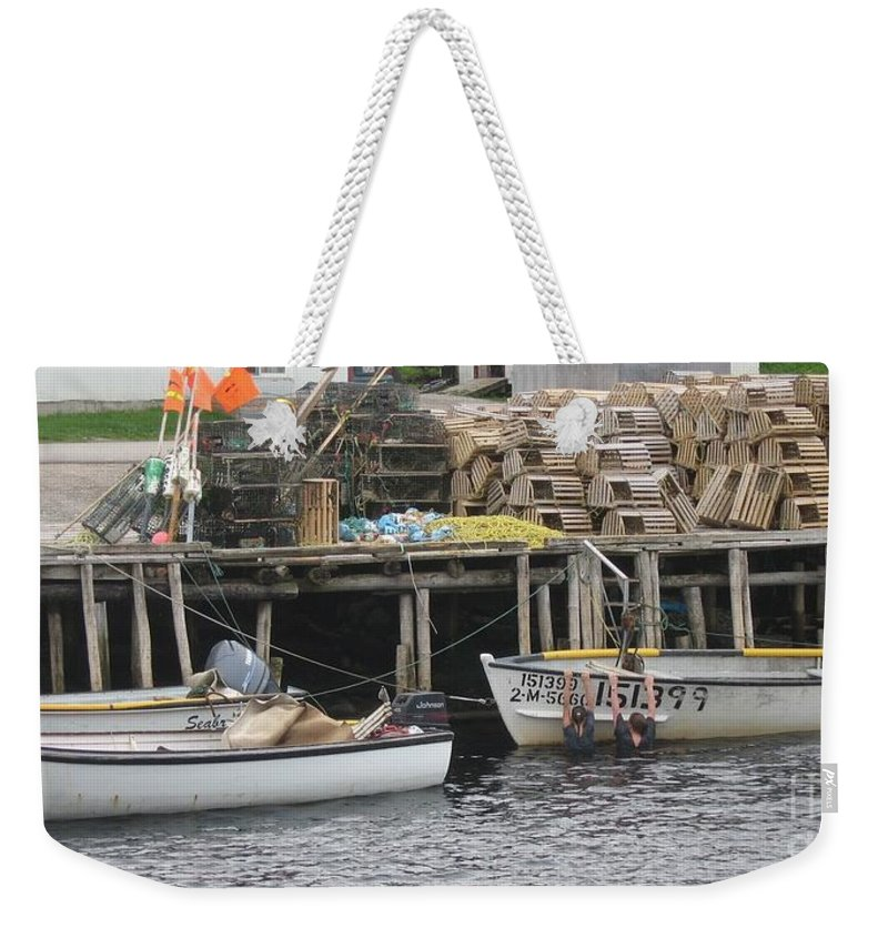 Photograph Atlantic Ocean Water Sea Swimming Girl Summer Newfoundland Bonnebay Boat Lobster Weekender Tote Bag featuring the photograph two girls swimming in the Atlantic Ocean by Seon-Jeong Kim