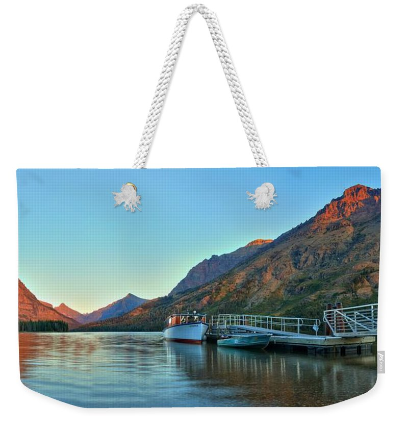 Two Medicine Weekender Tote Bag featuring the photograph Two Medicine Boat Dock by Adam Jewell