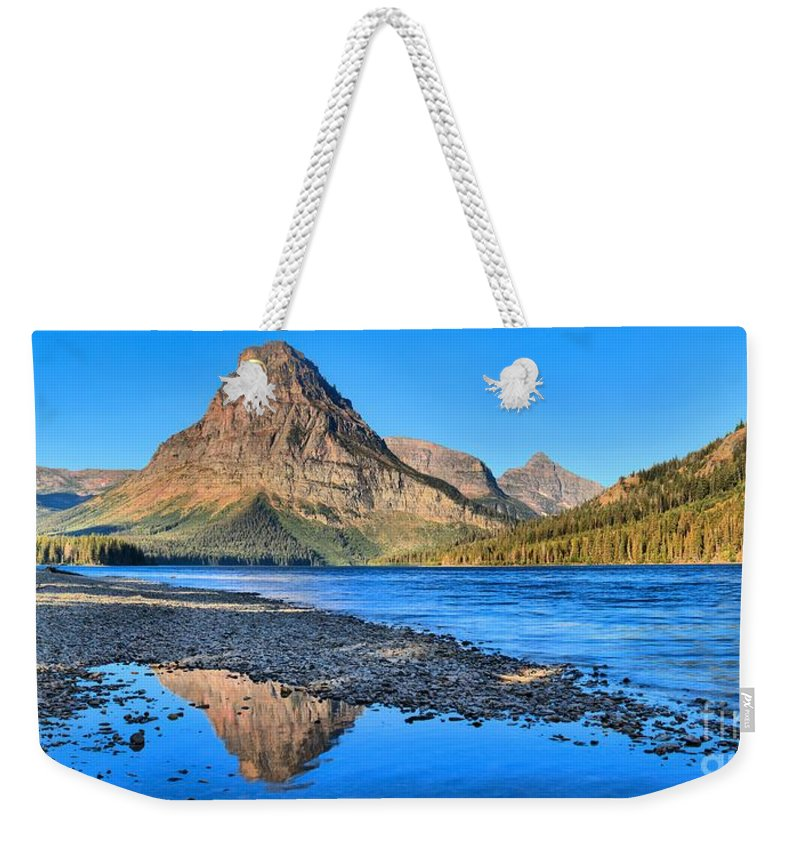 Two Medicine Weekender Tote Bag featuring the photograph Two Medicine Lake Sunrise Panorama by Adam Jewell
