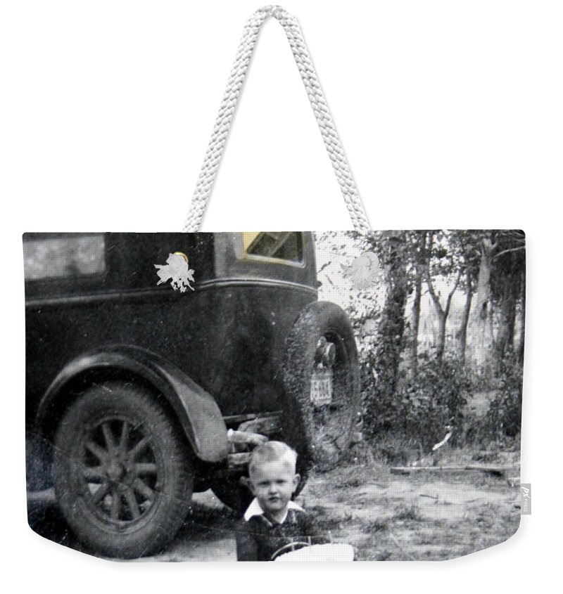 Classic Cars Antique Automobile Toy Toys Black And White Photograph Classic Weekender Tote Bag featuring the photograph Two Old Cars by Andrea Lawrence