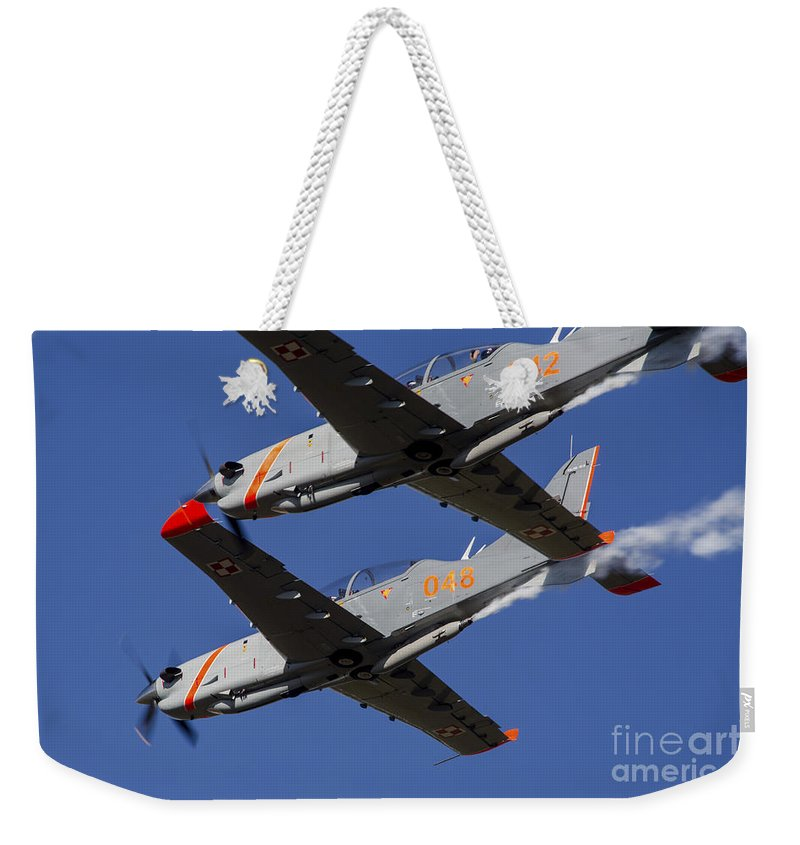 Ostrava Weekender Tote Bag featuring the photograph Two Pzl-130 Orlik Trainers by Timm Ziegenthaler