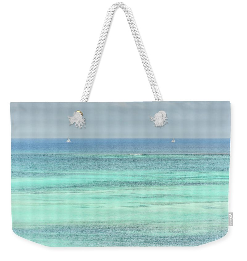 Vacation Weekender Tote Bag featuring the photograph Two Sailboats In The Bahamas by Anthony Doudt