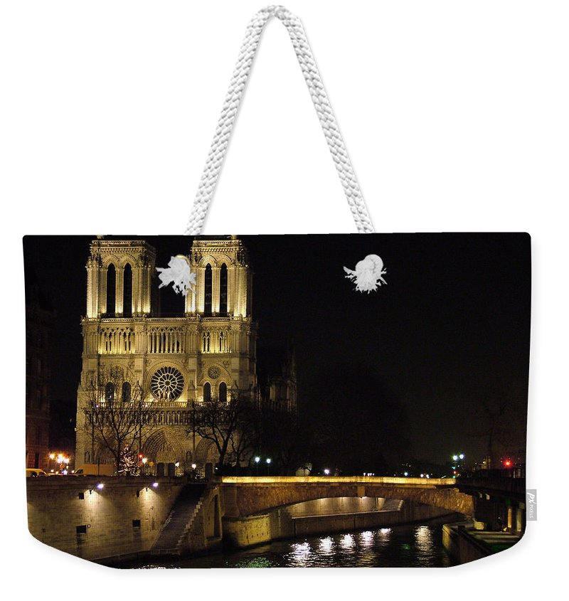 Two Weekender Tote Bag featuring the photograph Two Towers Of Notre Dame by Donna Corless