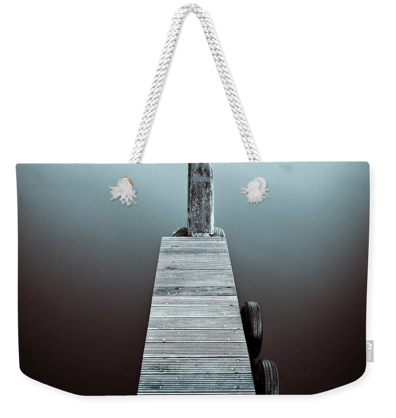 Jetty Weekender Tote Bag featuring the photograph Two Tyres by Dave Bowman