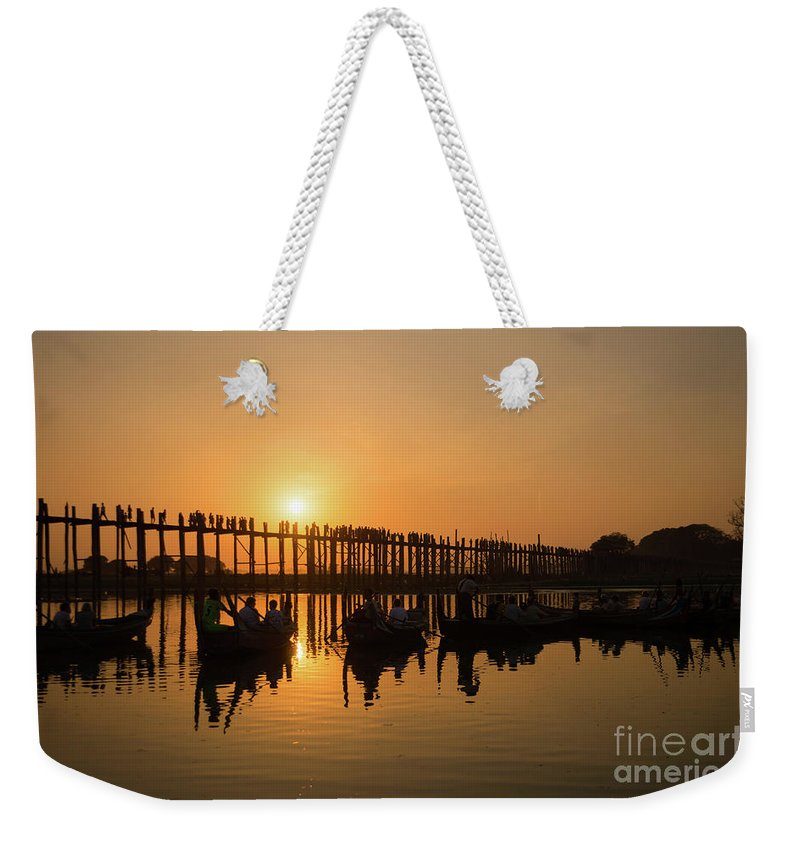 Burma Weekender Tote Bag featuring the photograph U Bein Bridge At Sunset by Louise Poggianti