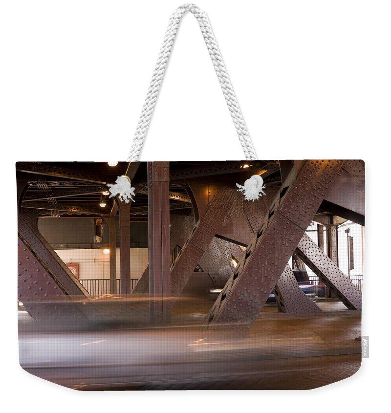 Chicago Windy City Bridge Steel Metal Car Fast Street Road Metro Urban Weekender Tote Bag featuring the photograph Under A Bridge by Andrei Shliakhau