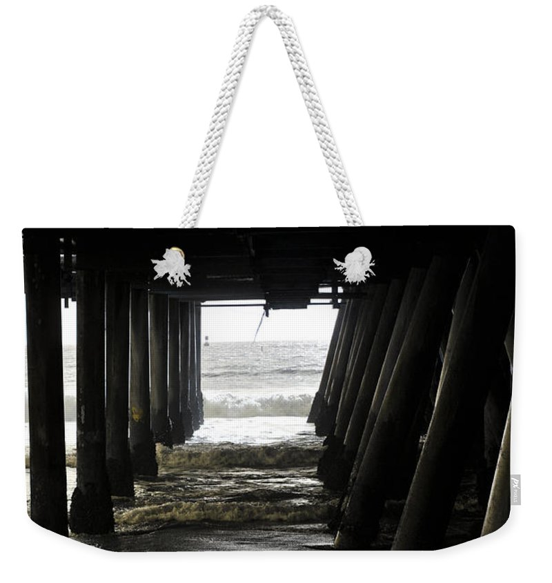 Clay Weekender Tote Bag featuring the photograph Under Santa Monica Pier by Clayton Bruster