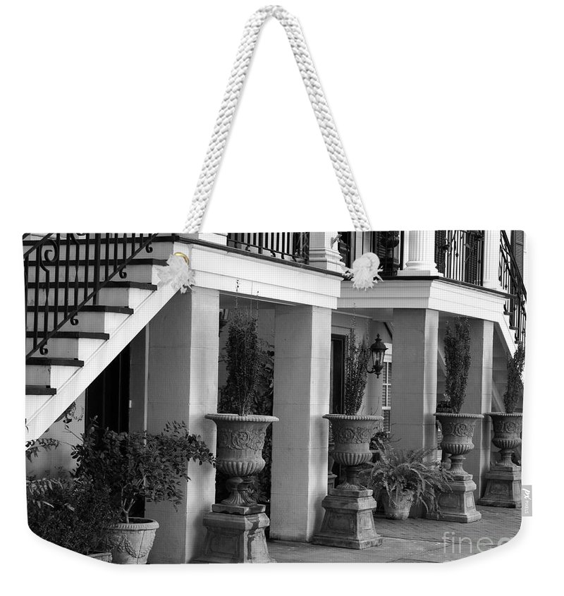 Savannah Weekender Tote Bag featuring the photograph Under The Steps In Savannah - Black And White by Carol Groenen