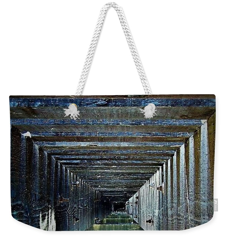 Weekender Tote Bag featuring the photograph Under Truss by Lisa Anne Warren