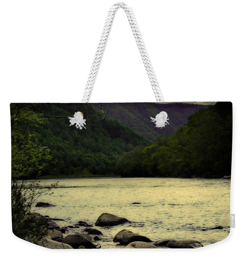 Lisa Lambert Weekender Tote Bag featuring the photograph Unity by Lj Lambert