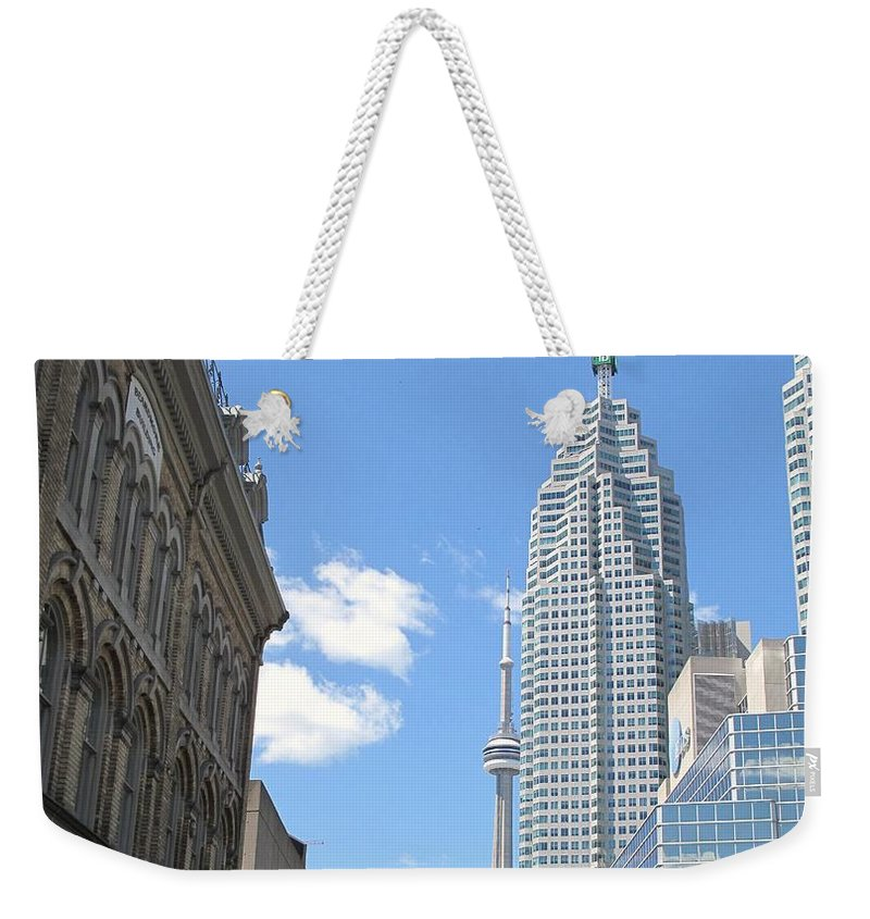 Front Street Weekender Tote Bag featuring the photograph Urban Canyon by Ian MacDonald