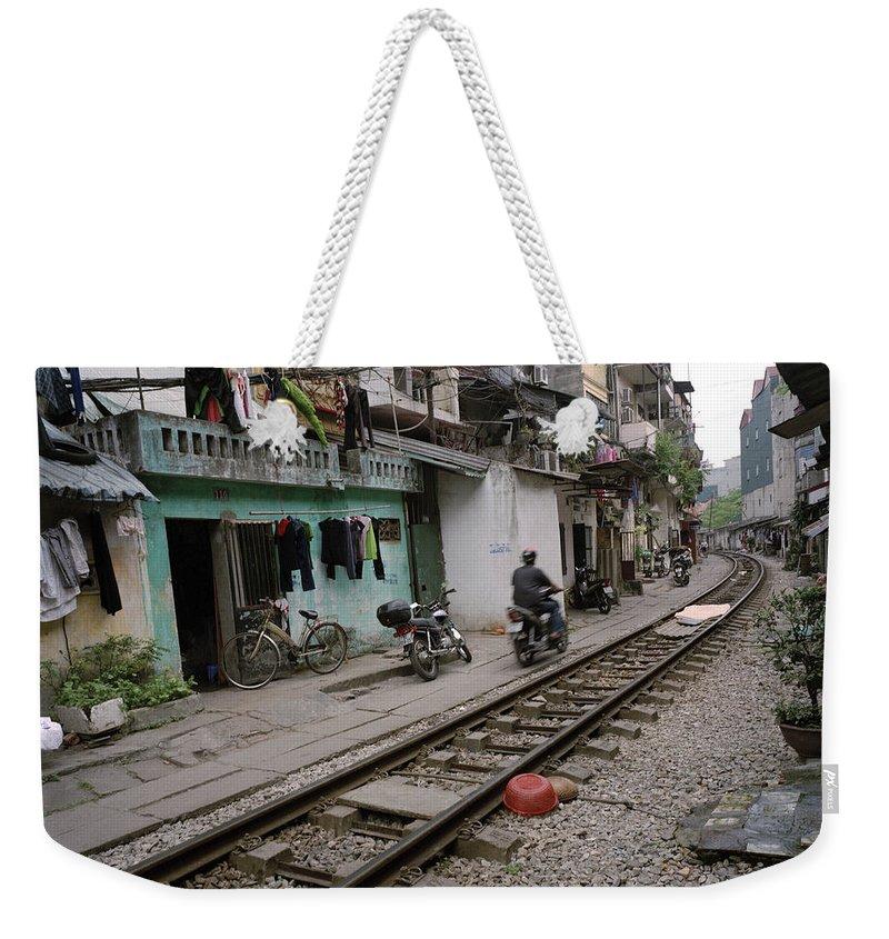 Hanoi Weekender Tote Bag featuring the photograph Urban Hanoi by Shaun Higson