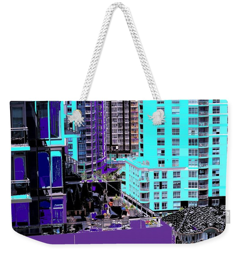 Weekender Tote Bag featuring the photograph Urban Jungle by Ian MacDonald
