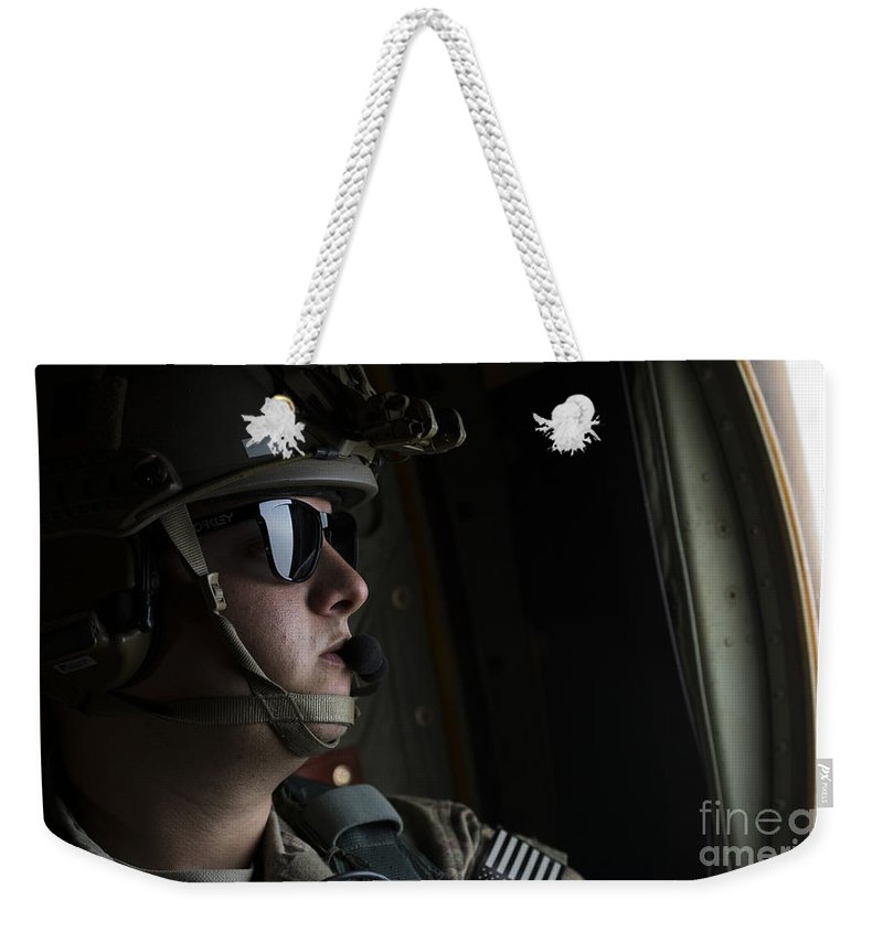 Exercise Emerald Warrior Weekender Tote Bag featuring the photograph U.s. Air Force Loadmaster Looks by Stocktrek Images