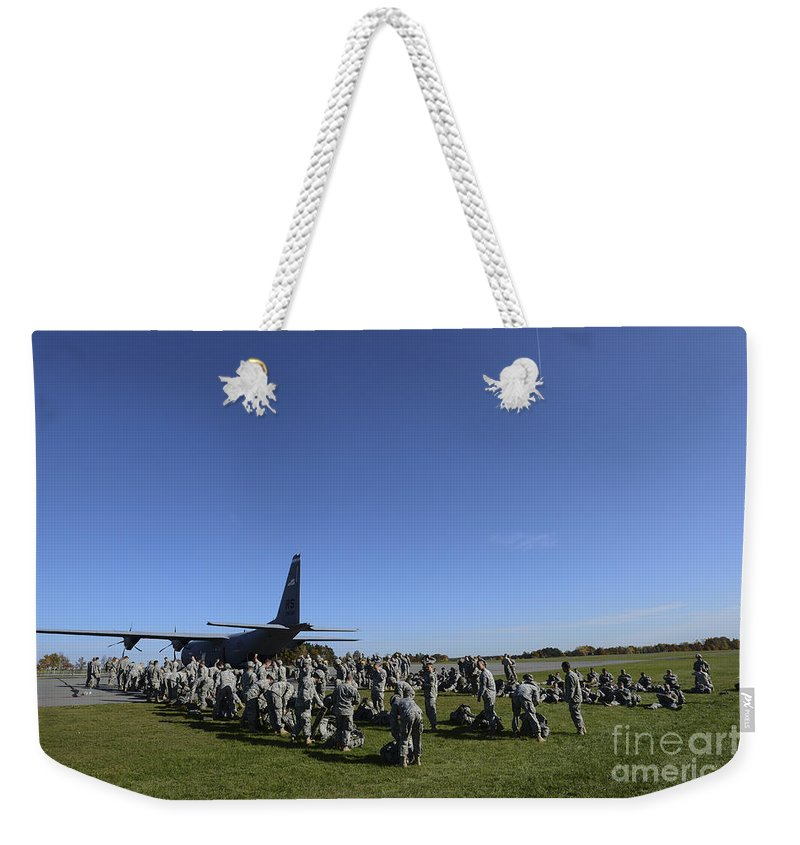 Us Army Weekender Tote Bag featuring the photograph U.s. Army Soldiers Conduct Pre-jump by Stocktrek Images