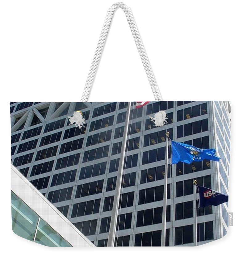 Us Bank Weekender Tote Bag featuring the photograph Us Bank With Flags by Anita Burgermeister