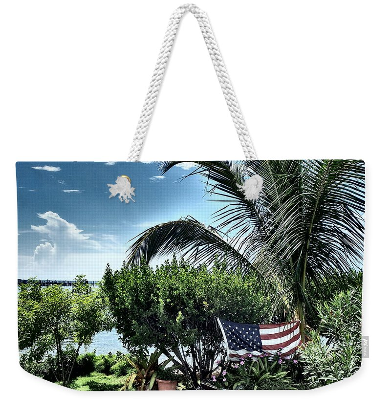 Amerian Flag Weekender Tote Bag featuring the photograph US Flag in the Abaco Islands, Bahamas by Cindy Ross