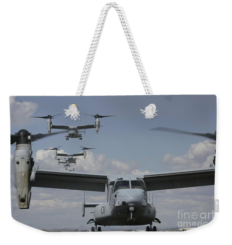 Mv-22 Osprey Weekender Tote Bag featuring the photograph U.s. Marine Corps Mv-22 Osprey by Stocktrek Images