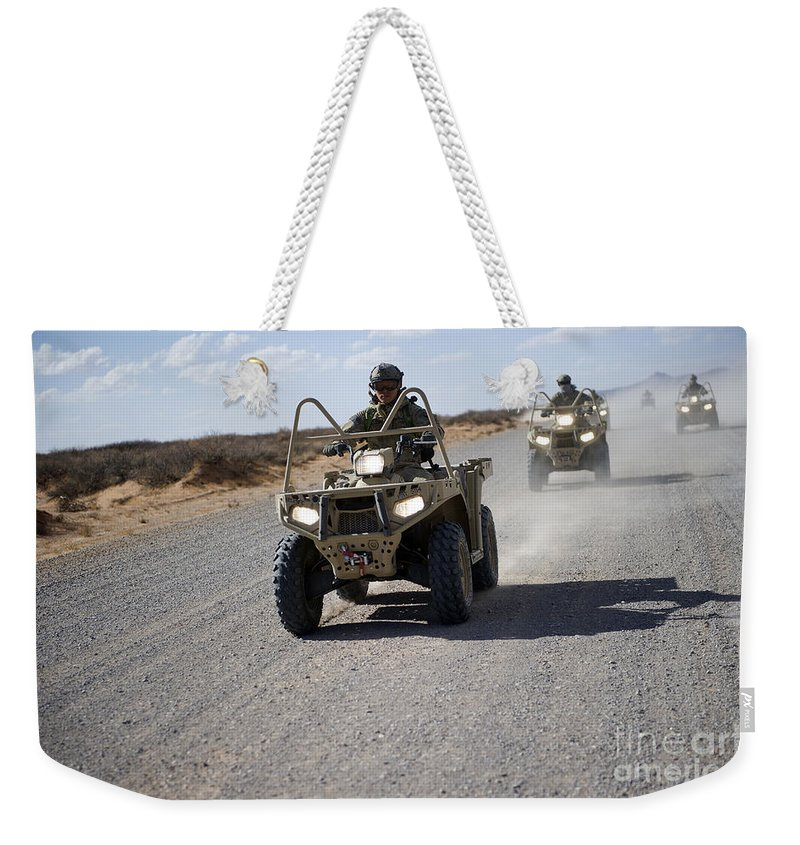 Soldier Weekender Tote Bag featuring the photograph U.s. Soldiers Perform Maneuvers by Stocktrek Images