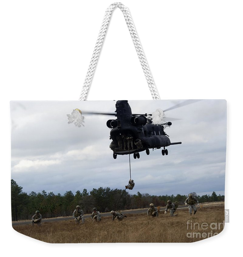 Soldier Weekender Tote Bag featuring the photograph U.s. Soldiers With The 7th Special by Stocktrek Images