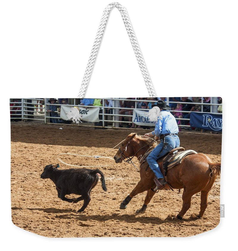 Rodeo Weekender Tote Bag featuring the photograph Using His Lasso by Sally Weigand