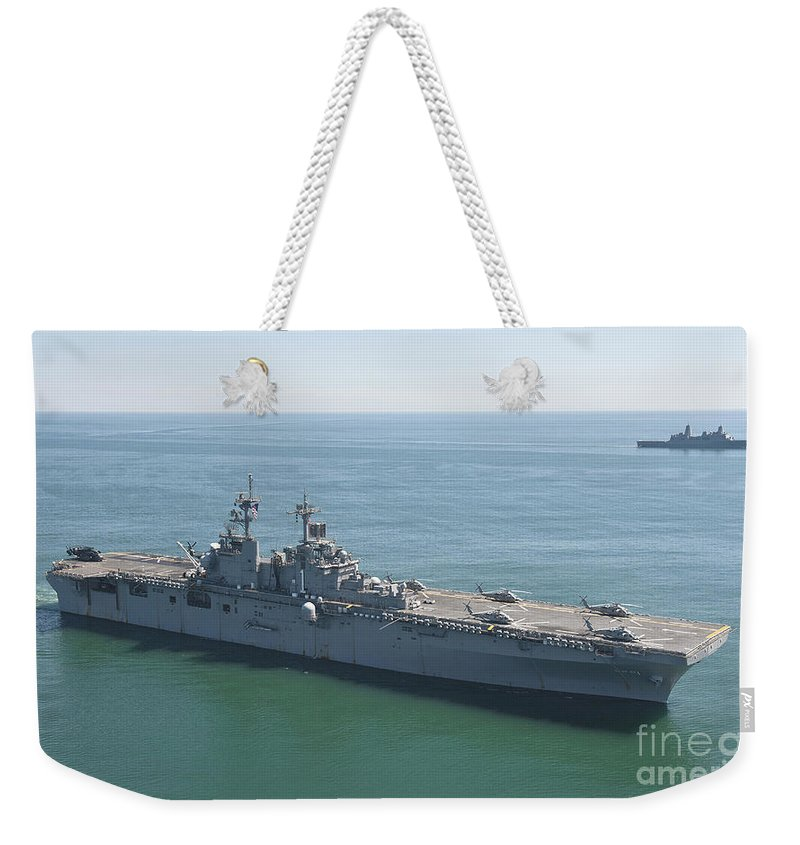 Uss Wasp Weekender Tote Bag featuring the photograph Uss Wasp And Uss San Antonio Transit by Stocktrek Images
