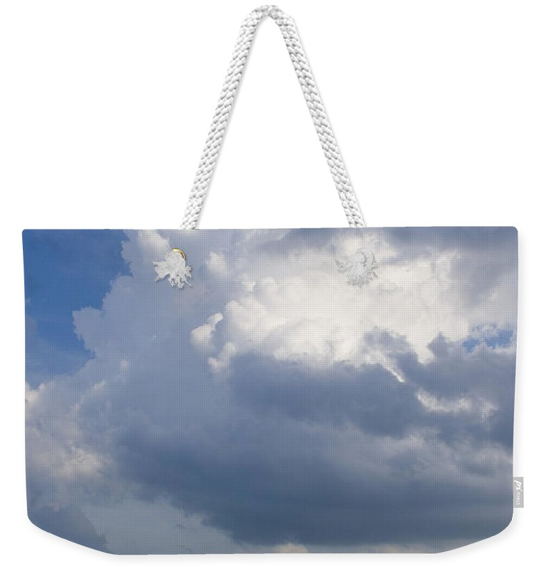 Ocean Nature Beach Sand Wave Water Sky Cloud White Bright Big Sun Sunny Vacation Relax Blue Weekender Tote Bag featuring the photograph Vessels In The Sky by Andrei Shliakhau