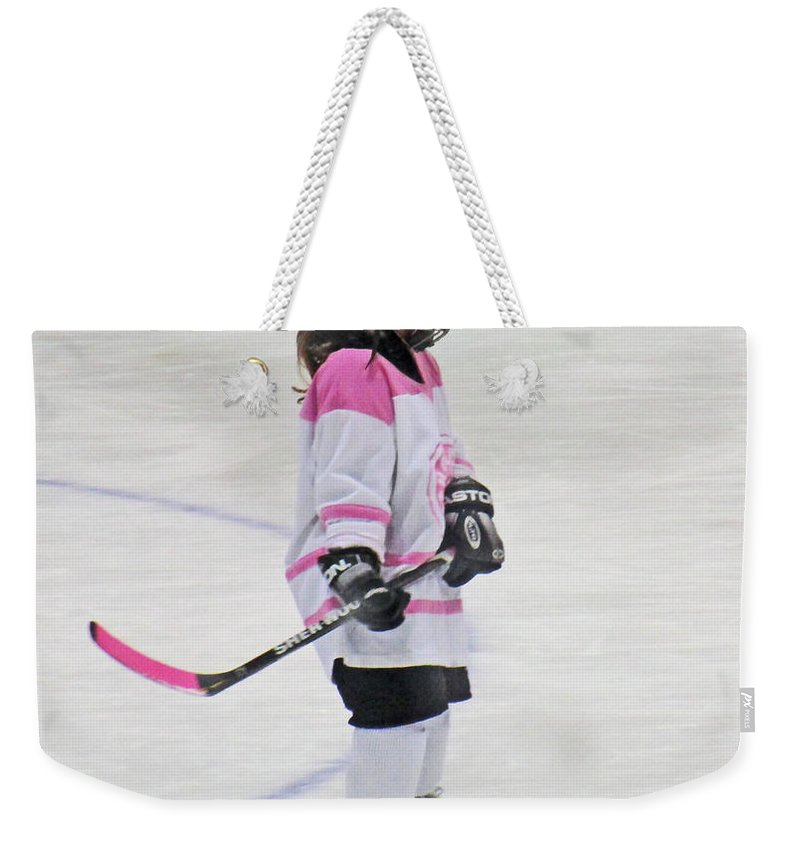Hockey Weekender Tote Bag featuring the photograph Vicious Hockey Player by Ian MacDonald