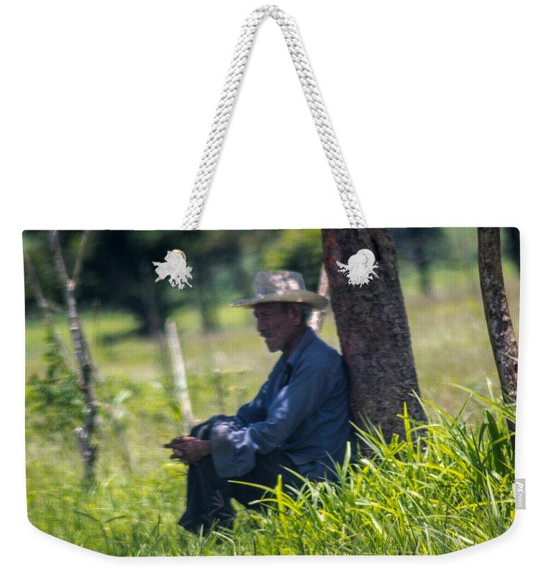 Old Man Weekender Tote Bag featuring the photograph Viejo Cuidando El Ganado 1 by Totto Ponce
