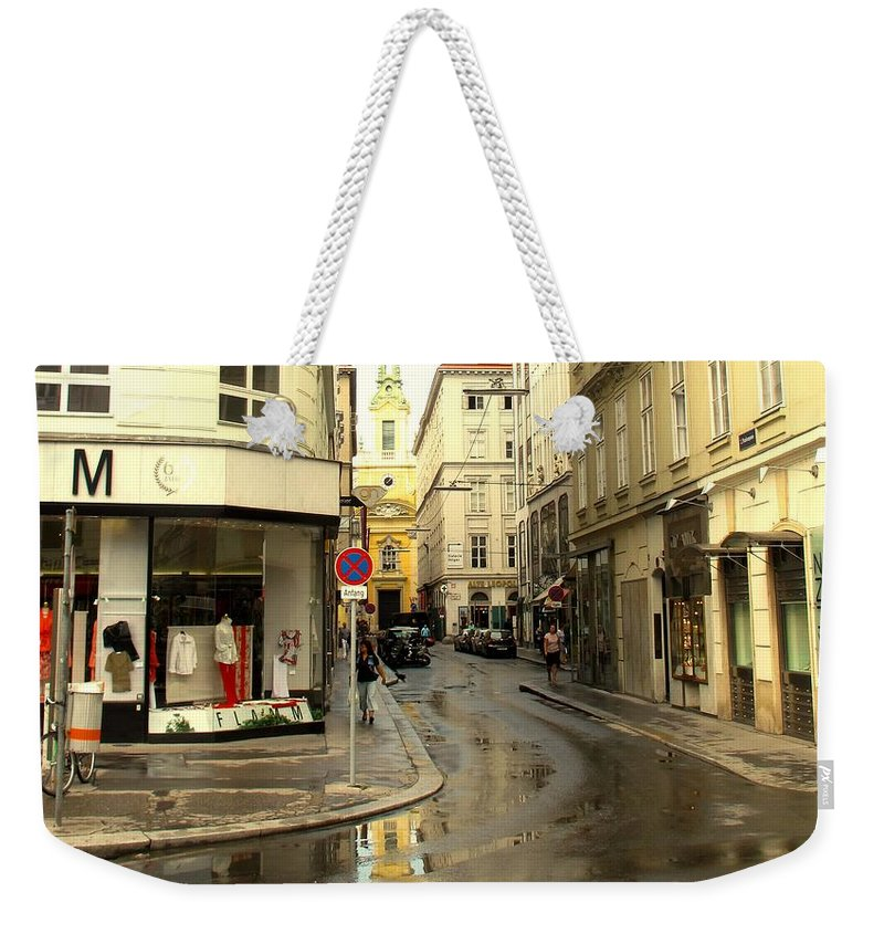 Vienna Weekender Tote Bag featuring the photograph Vienna Corner After The Rain by Ian MacDonald