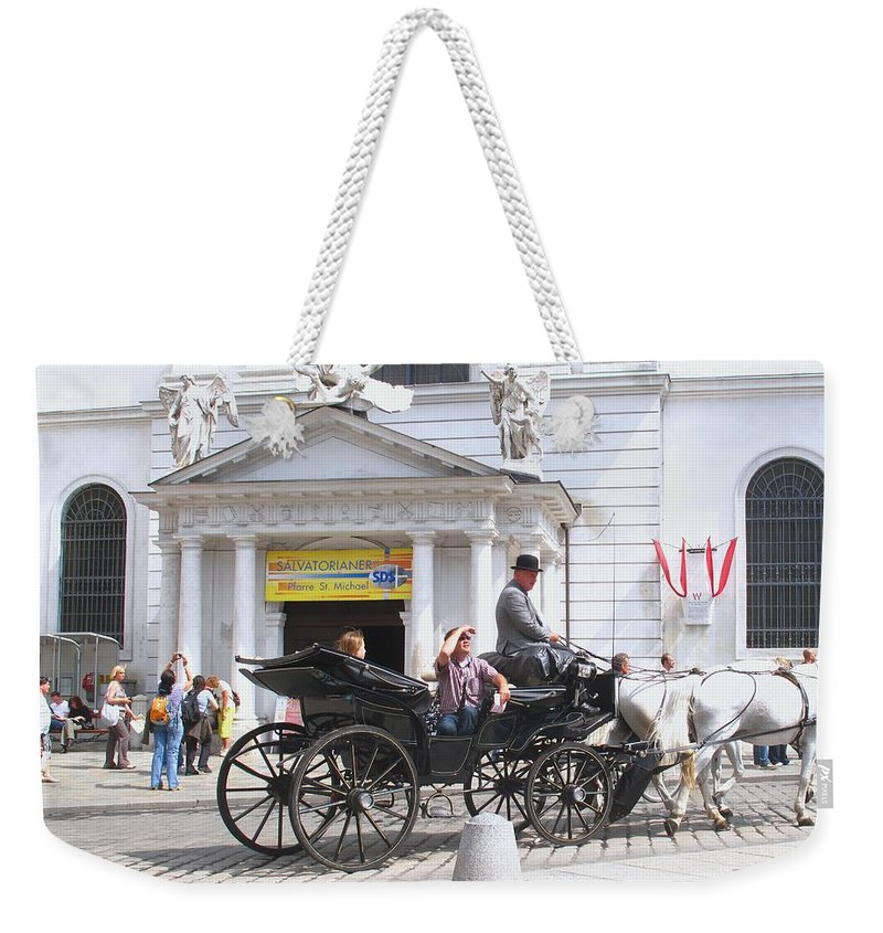 Carriage Weekender Tote Bag featuring the photograph Vienna Horse And Carriage by Ian MacDonald
