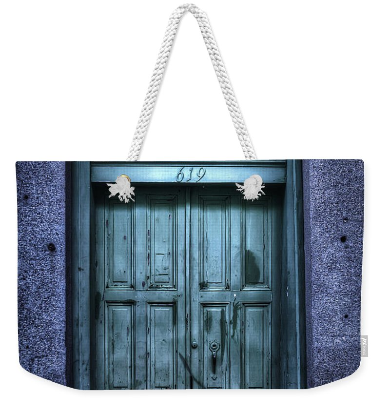 Nola Weekender Tote Bag featuring the photograph Vieux Carre' Doorway At Night by Tammy Wetzel