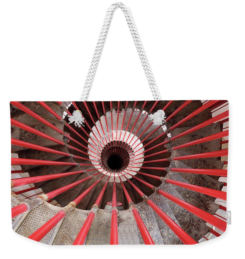 Down Weekender Tote Bag featuring the photograph View Down The Steel Double Helix Spiral Staircase At The Ljublja by Reimar Gaertner