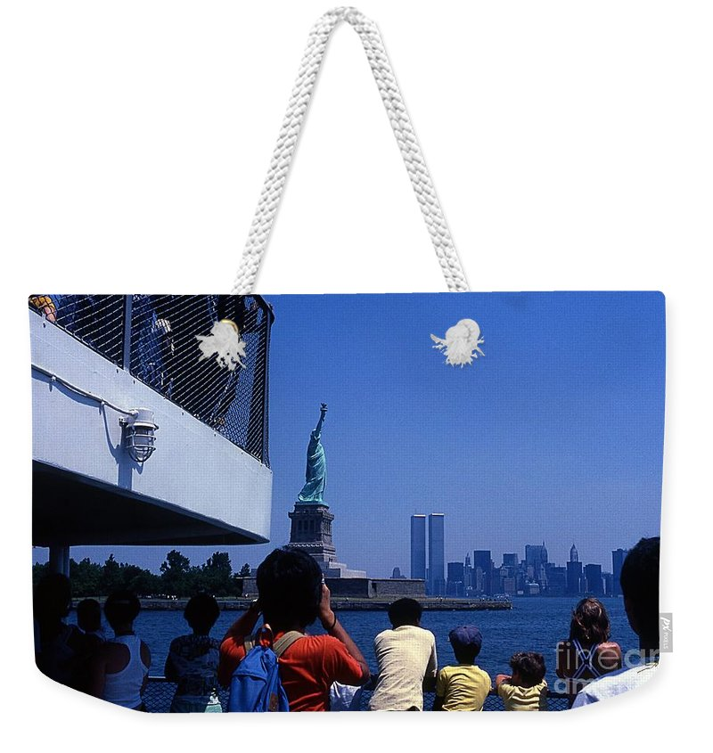 Statue Of Liberty World Trade Center Ferry Tourists Skyline Weekender Tote Bag featuring the photograph View Of Statue And Towers by Bob Bennett