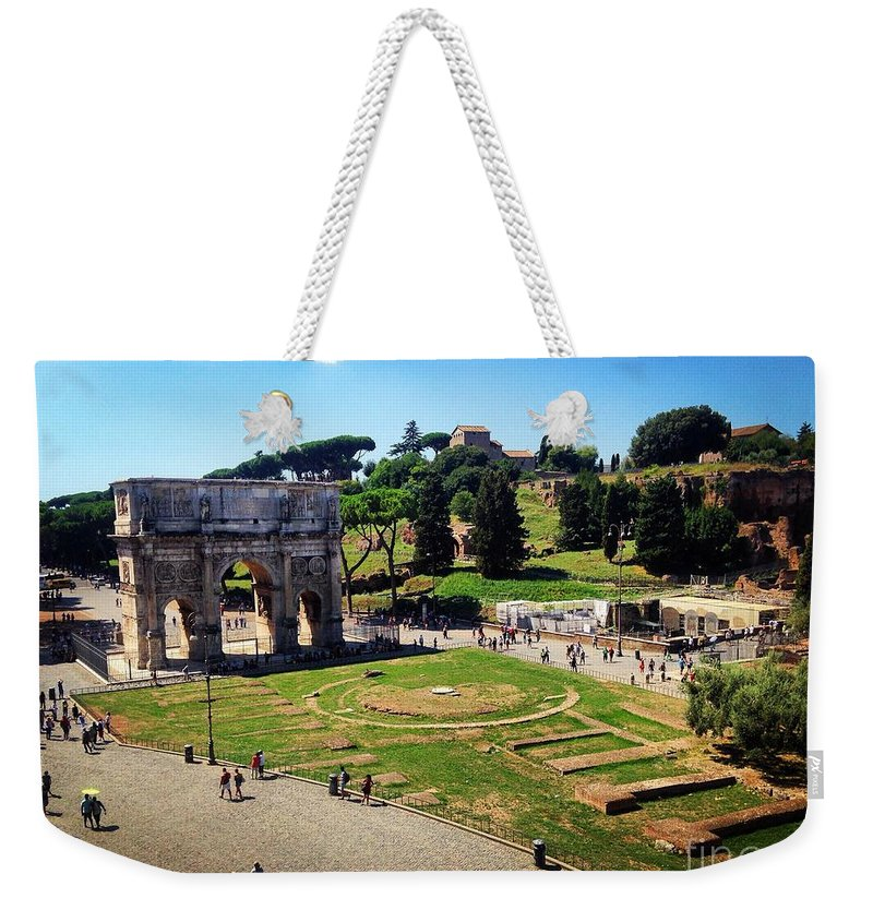 Rome Weekender Tote Bag featuring the photograph View Of The Arch Of Constantine From The Colosseum by Angela Rath
