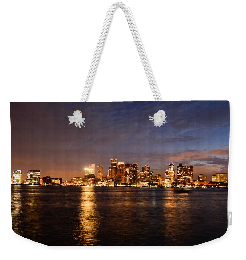 Boston Weekender Tote Bag featuring the photograph View Of The Boston Waterfront At Night by Nicole Freedman