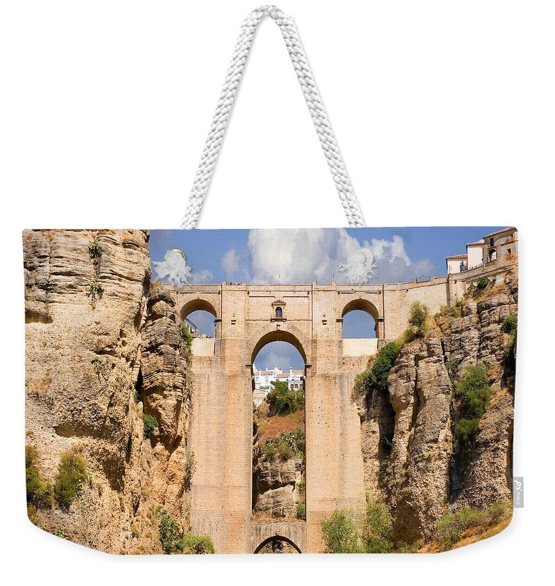 Ronda Weekender Tote Bag featuring the photograph View Of The Tajo De Ronda And The Puente Nuevo Bridge From Across The Valley by Mal Bray