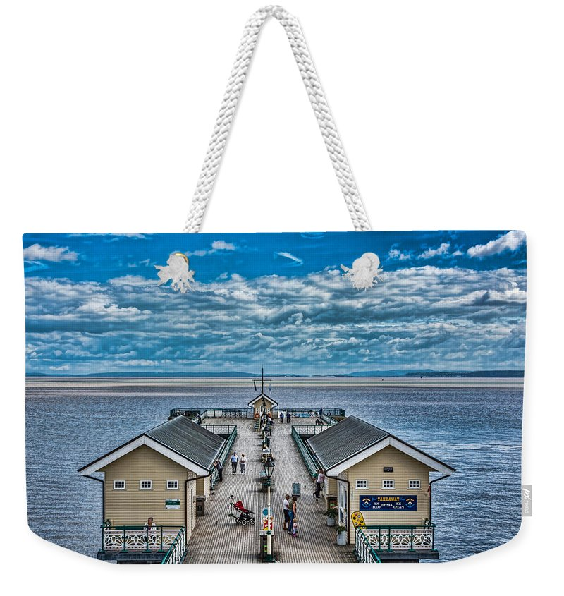 Penarth Pier Weekender Tote Bag featuring the photograph View Over The Pier by Steve Purnell