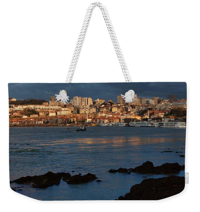 Vila Weekender Tote Bag featuring the photograph Vila Nova De Gaia In Portugal At Sunset by Artur Bogacki