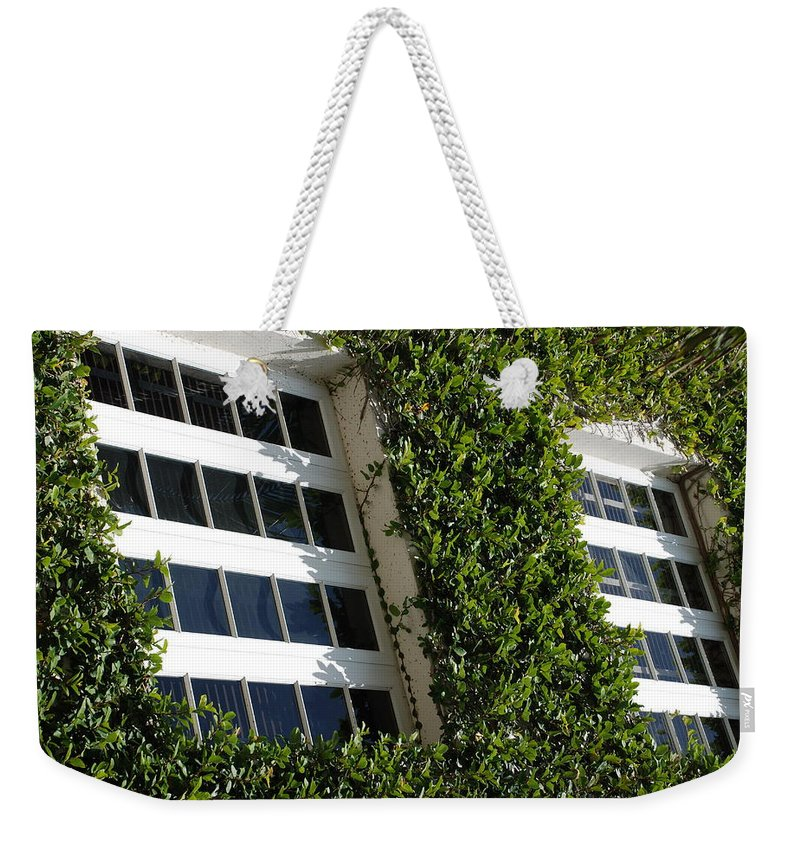 Architecture Weekender Tote Bag featuring the photograph Vines And Glass by Rob Hans
