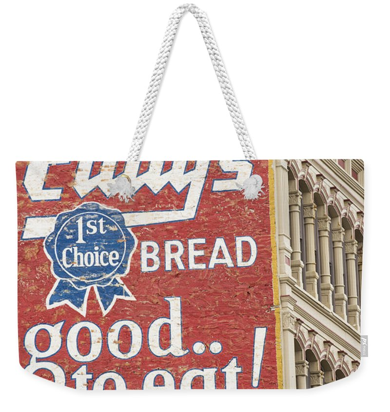 Advertisement Weekender Tote Bag featuring the photograph Vintage Brickwall Advertisement by Juli Scalzi