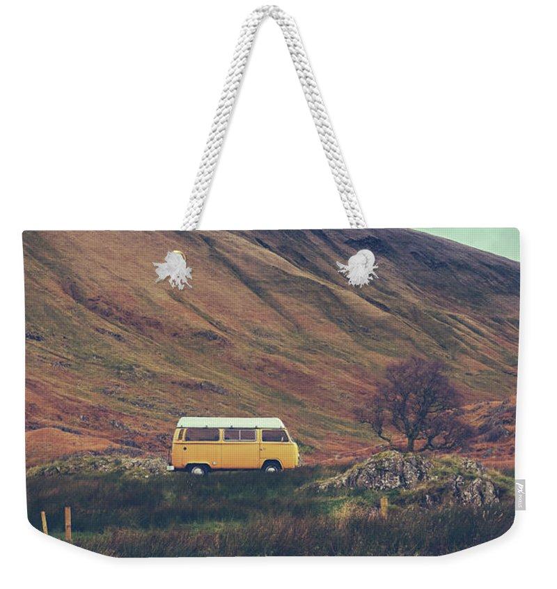 Europe Weekender Tote Bag featuring the photograph Vintage Camper Van In The Wilderness by Mr Doomits