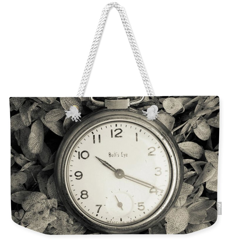 Still Life Weekender Tote Bag featuring the photograph Vintage Pocket Watch Over Flowers by Edward Fielding