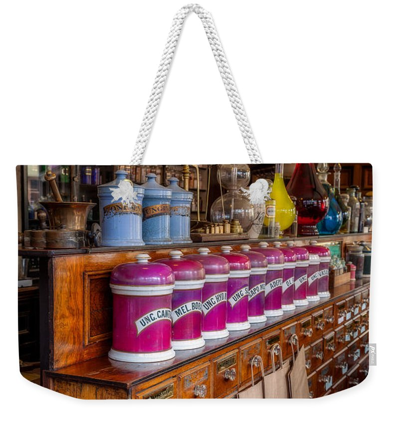 Medicine Weekender Tote Bag featuring the photograph Vintage Store by Adrian Evans