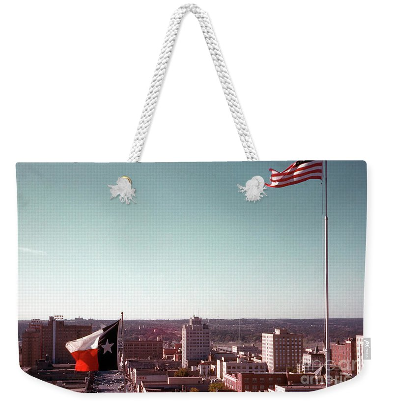 Vintage Weekender Tote Bag featuring the photograph Vintage View Of The Texas And Usa Flags Flying On Top Of Texas State Capitol by Herronstock Prints