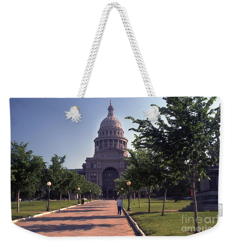Vintage View Weekender Tote Bag featuring the photograph Vintage View Of The Texas State Capitol In Downtown Austin, Texas by Herronstock Prints