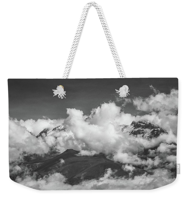 Clouds Weekender Tote Bag featuring the photograph Volcano Chachani In Arequipa Peru Covered By Clouds by Jiri Vondrous