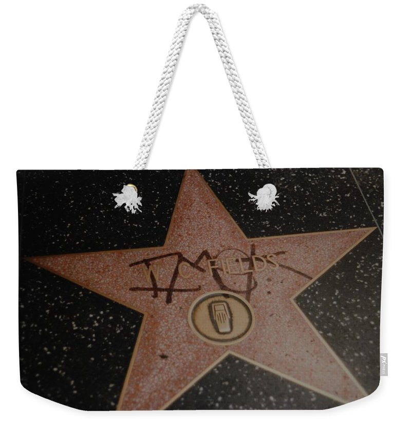 Hollywood Weekender Tote Bag featuring the photograph W C Fields Star by Rob Hans